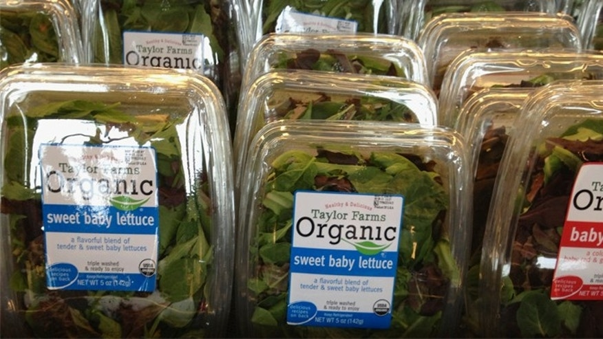 Packages of Taylor Farms salads are offered for sale at a supermarket in Omaha, Neb. The FDA said it traced an outbreak of stomach illnesses from restaurants in Nebraska and Iowa to Taylor Farms de Mexico, the Mexican branch of Salinas, Calif.-based Taylor Farms.