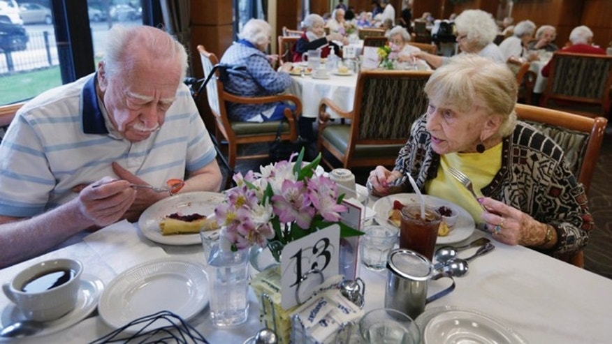 In this July 30, 2013, photo, 92-year-old Edith Stern, right, has lunch in the cafeteria at her retirement home in Chicago. Stern is a âsuper ager,â participating in a Northwestern University study of people in their 80s and 90s with astounding memories. So far the research has found scientific evidence that brains in this elite group resemble those of people decades younger. (AP Photo/M. Spencer Green)
