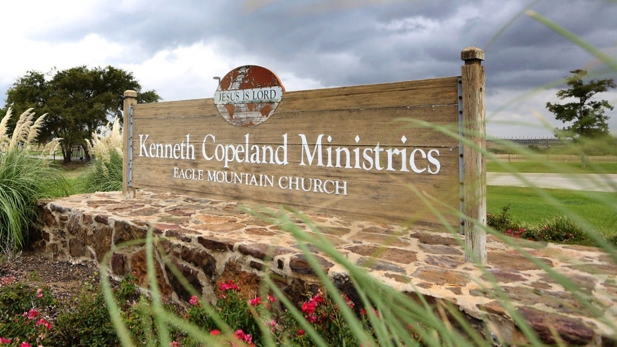 A sign marks the entrance of the Kenneth Copeland Ministries Eagle Mountain Church, Tuesday, Aug. 27, 2013, in Newark, Texas.