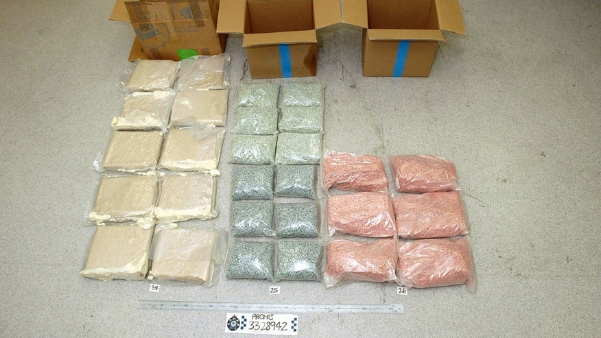 Bags of MDMA tablets. Popular street drug 'Molly' is a powdered form of MDMA.