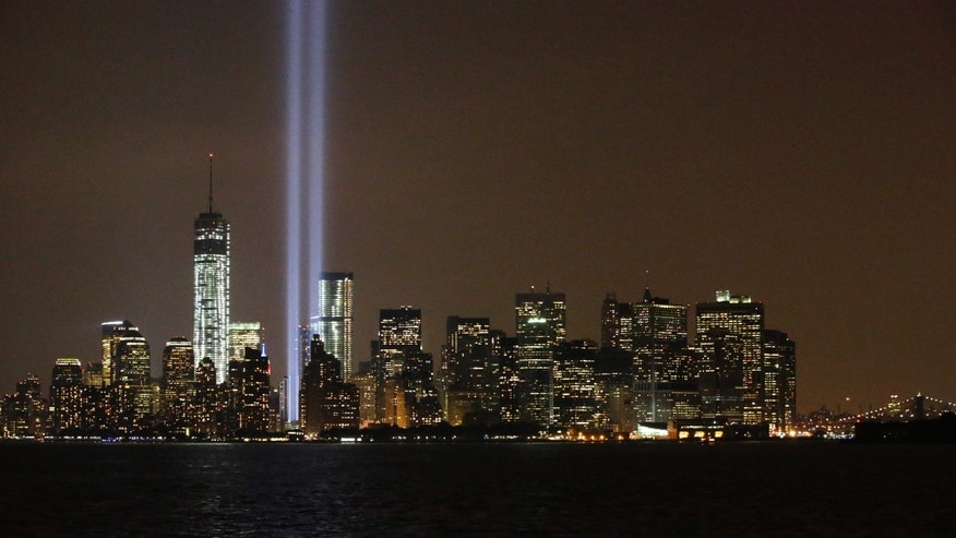 The twin beams of the annual Tribute in Light commemorating the September 11, 2001 terrorist attacks shine above the city';s skyline Wednesday, Sept. 11, 2013, in New York, on the 12th anniversary of the attacks.