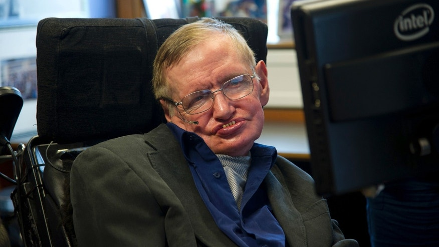 British physicist Stephen Hawking sits at his desk in the Applied Mathematics Department of Cambridge University August 30, 2012. (REUTERS/Guillermo Granja/Vice Presidency of Ecuador/Handout)
