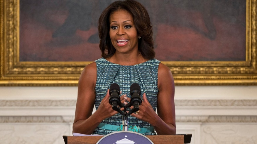 First lady Michelle Obama in the State Dining Room of the White House on Sept. 18, 2013, in Washington.