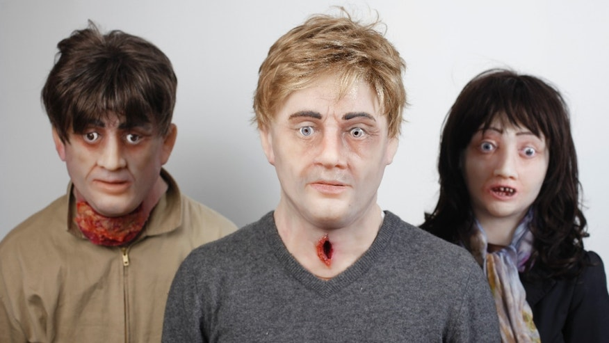 Actors wearing specially commissioned Halloween style masks representing the damaging effects caused by smoking, approach members of the public in London, to promote a stop smoking campaign this October by online clinic HealthExpress.
