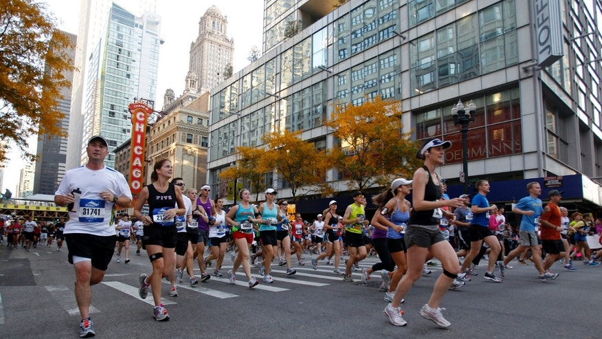 Runners participate in the Chicago Marathon October 9, 2011. (REUTERS/Kamil Krzaczynski)