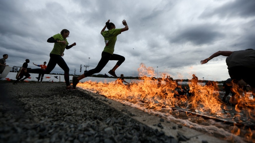 Obstacles require athletes to run through fire, plunge into icy water or climb over vertical walls.