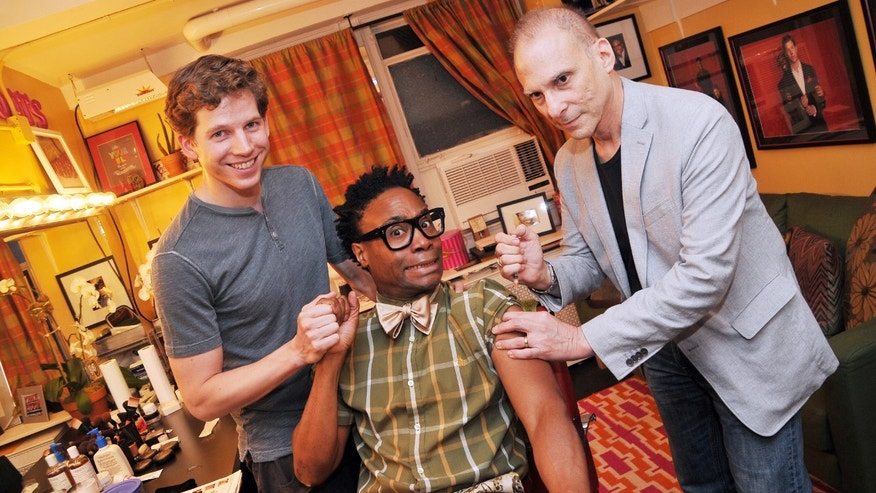 "Actor Stark Sands, Left, holding hands with Billy Porter, center, both of ""Kinky Boots"" as Dr. Barry Kohn administers the flu shot in New York."