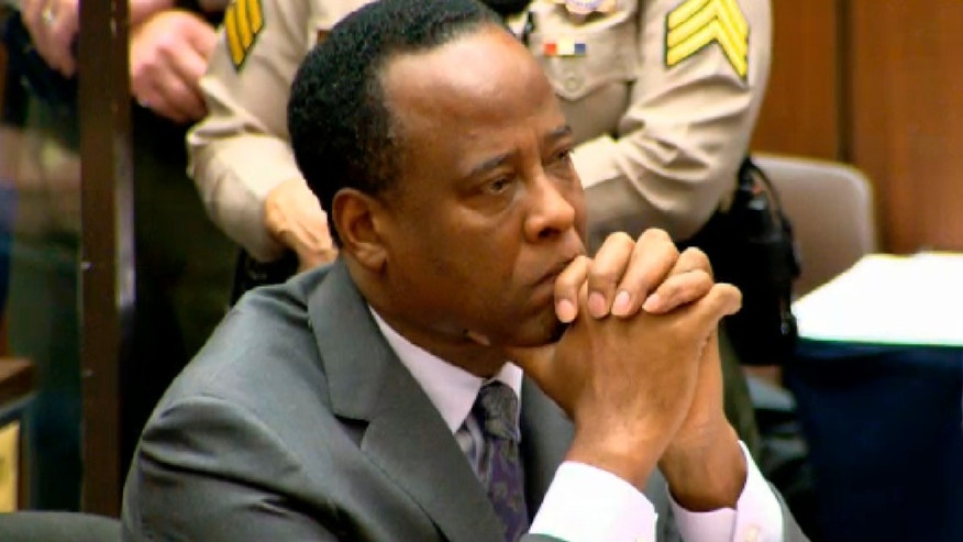 Dr. Conrad Murray listens as Judge Michael Pastor sentences him to four years in county jail for his involuntary manslaughter conviction of pop star Michael Jackson. (REUTERS/CNN/Pool)