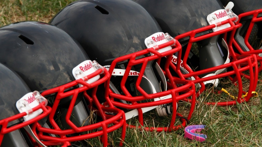 This file photo shows football helmets that were given to a group of youth football players from the Akron Parents Pee Wee Football League, in Akron, Ohio.