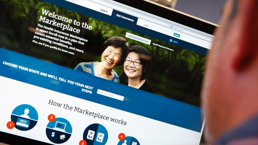 A man looks over the Affordable Care Act (commonly known as Obamacare) signup page on the HealthCare.gov website in New York.