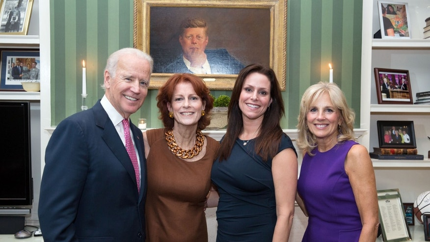 Vice President Joe Biden and Dr. Jill Biden pose with Noreen Fraser and Michelle McBride at a breast cancer awareness month reception in the library of the Naval Observatory Residence in Washington, D.C..