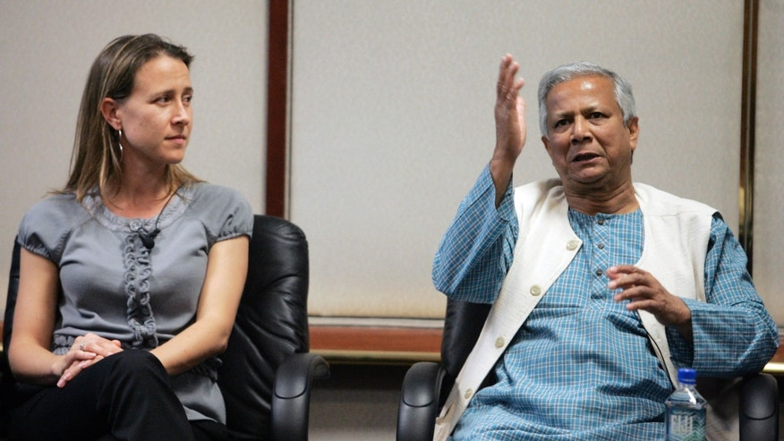 Panelists Anne Wojcicki, co-founder of 23and Me Inc. and 2006 Nobel Peace Prize Laureate Muhammad Yunus (R), a panel at the Global Overview panel at 2008 Milken Institute Global Conference in Beverly Hills California April 28, 2008. (REUTERS/Fred Prouser)