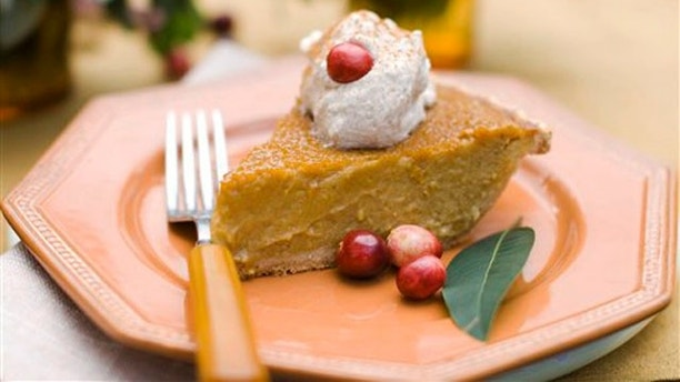 In this image taken on Oct. 8, 2012, a slice of maple pumpkin pie with cinnamon-maple whipped cream is shown served on a plate in Concord, N.H. (AP Photo/Matthew Mead)