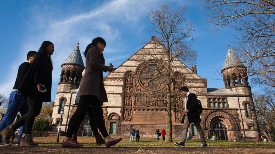 People walk around the Princeton University campus in New Jersey, November 16, 2013. (REUTERS/Eduardo Munoz)
