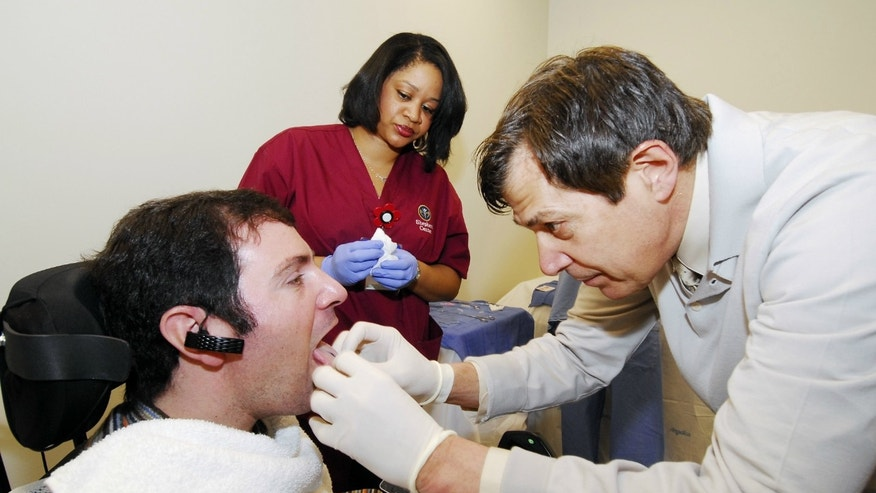 Jason DiSanto receives a tongue implant to test the Tongue Drive System.