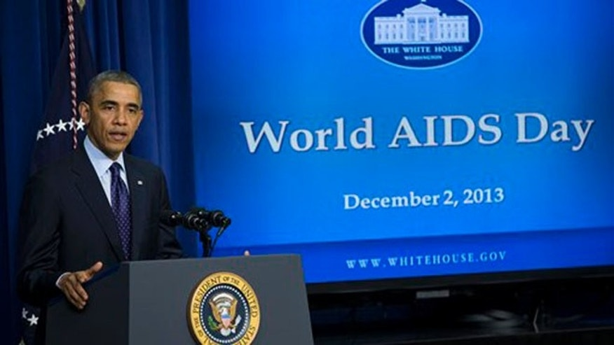 President Barack Obama gestures while speaking at a world AIDS Day event, Monday, Dec. 2, 2013, in the South Court Auditorium on the White House complex in Washington. (AP Photo/ Evan Vucci)