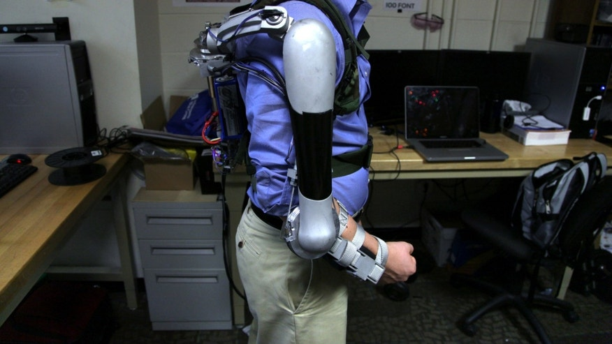Nick McGill wears the Titan Arm as he poses at the University of Pennsylvania in Philadelphia. (AP Photo/Jacqueline Larma)