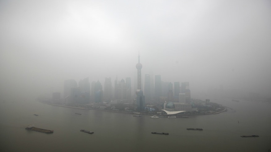 The financial district of Pudong is seen on a hazy day in Shanghai.
