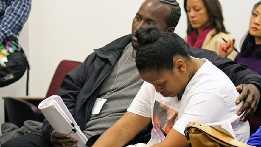 December 20, 2013: Nailah Winkfield, mother of 13-year-old Jahi McMath, is comforted by her husband Martin Winkfield, left, and another family member as they wait for a hearing to start in Department 31 in the Post Office Building in Oakland, Calif. A judge on Friday ordered a California hospital to keep a girl declared brain dead on life support following what was supposed to be a routine tonsillectomy. (AP Photo/The Tribune, Laura A. Oda)