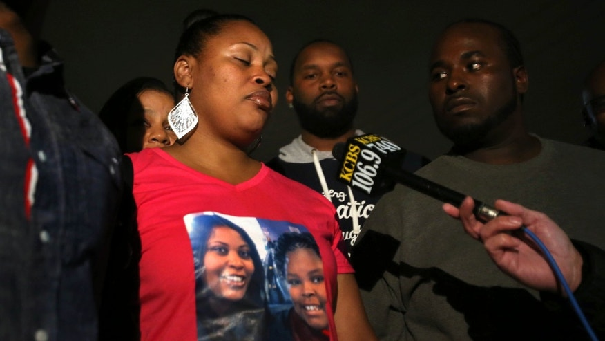 Nailah Winkfield, mother of Jahi McMath, 13, speaks to reporters after the family held a prayer vigil for her daughter at Paradise Baptist Church in Oakland, Calif. (AP Photo/Bay Area News Group, Ray Chavez)