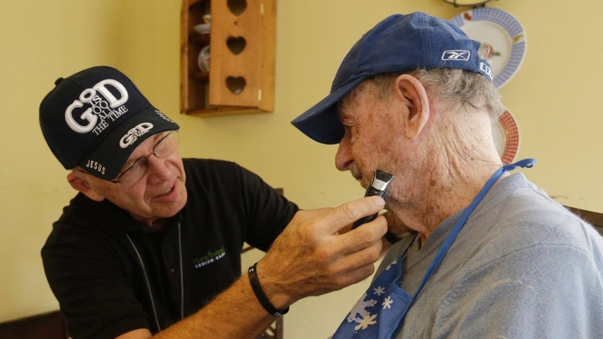 Caregiver Warren Manchess, 74, left, shaves Paul Gregoline, in Noblesville, Ind. (AP Photo/Darron Cummings)