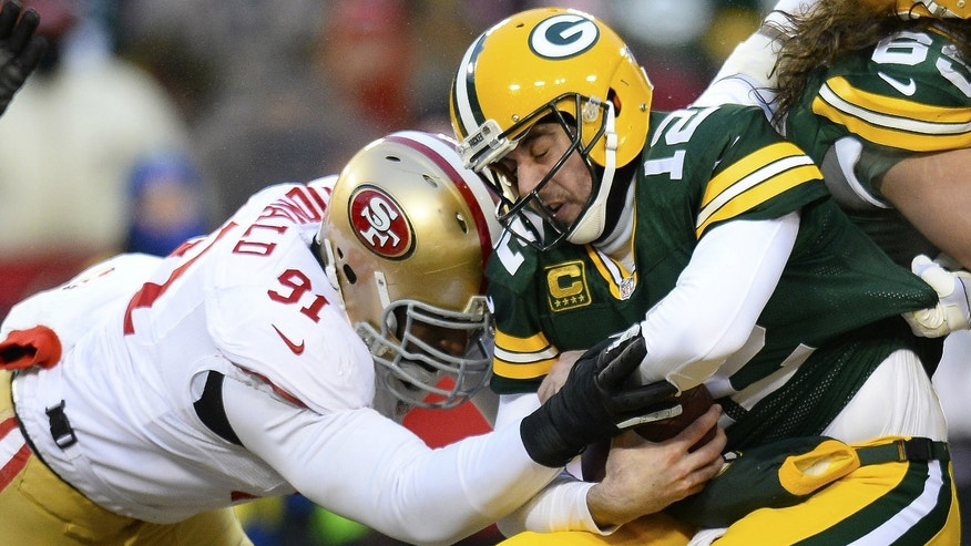 San Francisco 49ers defensive end Ray McDonald (91) sacks Green Bay Packers quarterback Aaron Rodgers (12) during the first quarter of the 2013 NFC wild card playoff football game at Lambeau Field.