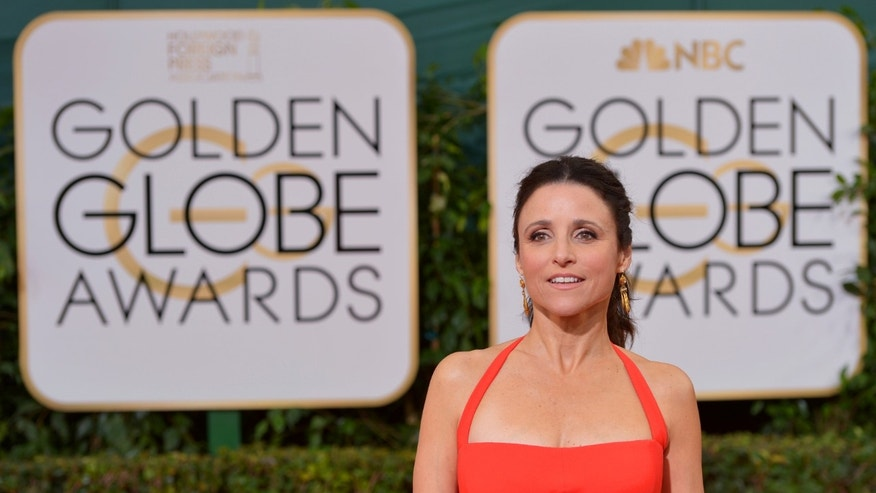 Julia Louis-Dreyfus arrives at the 71st annual Golden Globe Awards at the Beverly Hilton Hotel on Sunday, Jan. 12, 2014. (Photo by John Shearer/Invision/AP)