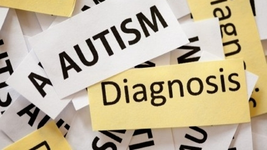 "Snippets of paper reading ""Autism Diagnosis"" on them."