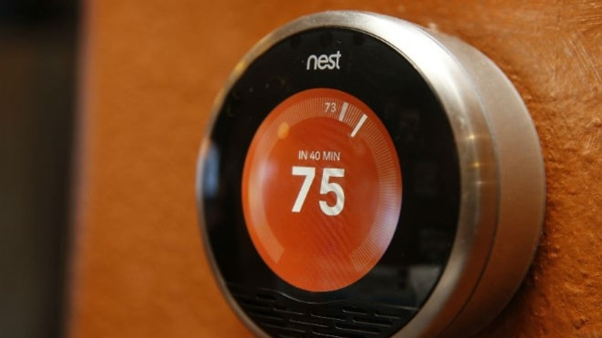 A Nest thermostat is installed in a home. (REUTERS/George Frey)