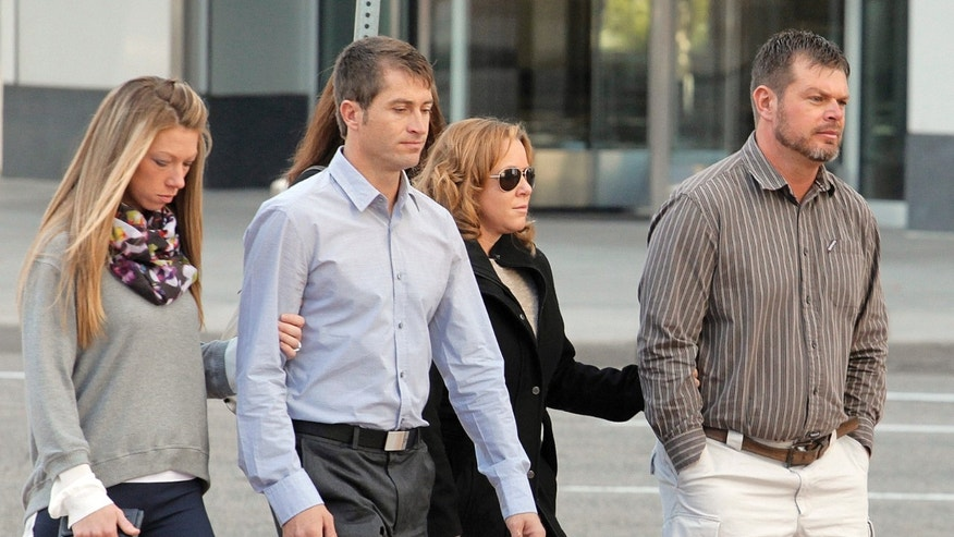 Eric Jensen, right and Ryan Jensen, brothers who owned and operated Jensen Farms, arrive at the federal courthouse in Denver with family in October. (AP Photo/Ed Andrieski, File)