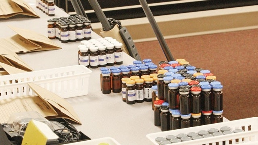 FILE - This Dec. 9, 2013 file photo shows vials of steroids during a news conference at the El Dorado Police Department in after multiple agencies shut down a large steroid manufacturing and distribution ring in El Dorado, Ark. (AP)