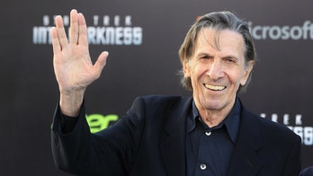 """Leonard Nimoy, cast member of the new film """"Star Trek Into Darkness"""", poses as he arrives at the film's premiere in Hollywood."""