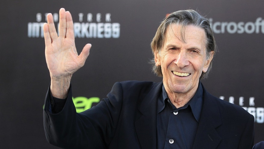 "Leonard Nimoy, cast member of the new film ""Star Trek Into Darkness"", poses as he arrives at the film's premiere in Hollywood."