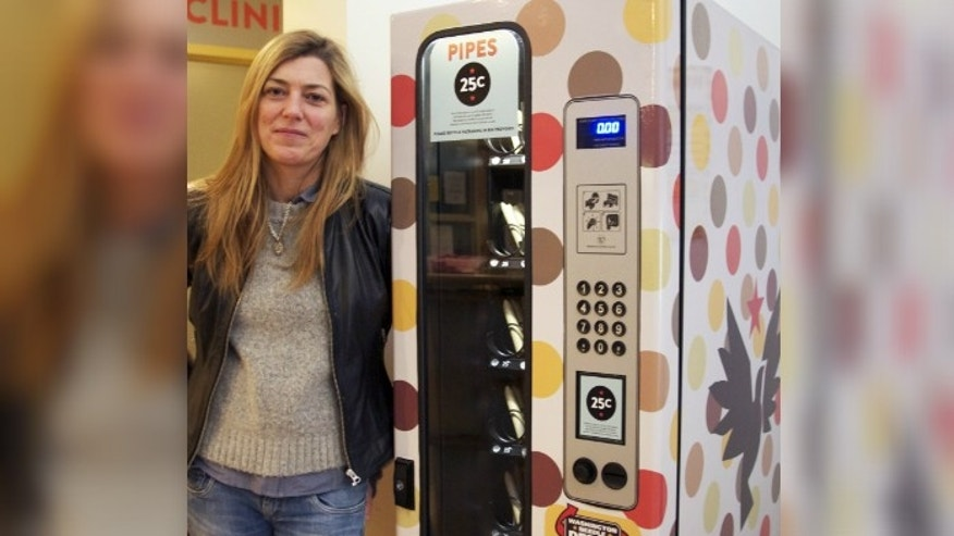 Liz Evans, executive director of the Portland Hotel Society, stands next to the newly added crack pipe vending machine. Photo: Colin Askey