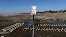 A sign is shown by an empty boat marina at Folsom Lake, which is 17 percent of its capacity, in Folsom, California January 22, 2014. (REUTERS/Robert Galbraith)