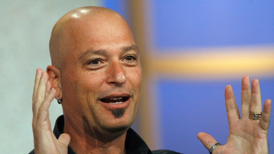 "Host Howie Mandel gestures at the panel for the NBC television show  ""Deal Or No Deal"" at the Television Critics Association summer 2006 media tour. (REUTERS/Mario Anzuoni)"