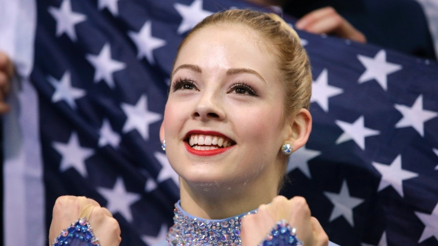 Gracie Gold of the United States reacts in the results area after competing in the women's team free skate figure skating competition in Sochi, Russia. (AP Photo/Darron Cummings, Pool)
