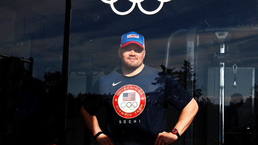 U.S. bobsled pilot Steve Holcomb poses for a picture at the fitness center in the Coastal Cluster Olympic Village in Sochi, February 4, 2014. (REUTERS/Eric Gaillard)