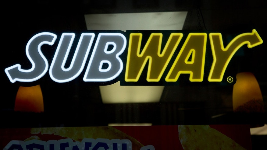 A Subway sandwich shop logo is pictured in the Manhattan borough of New York February 14, 2014. (REUTERS/Carlo Allegri)