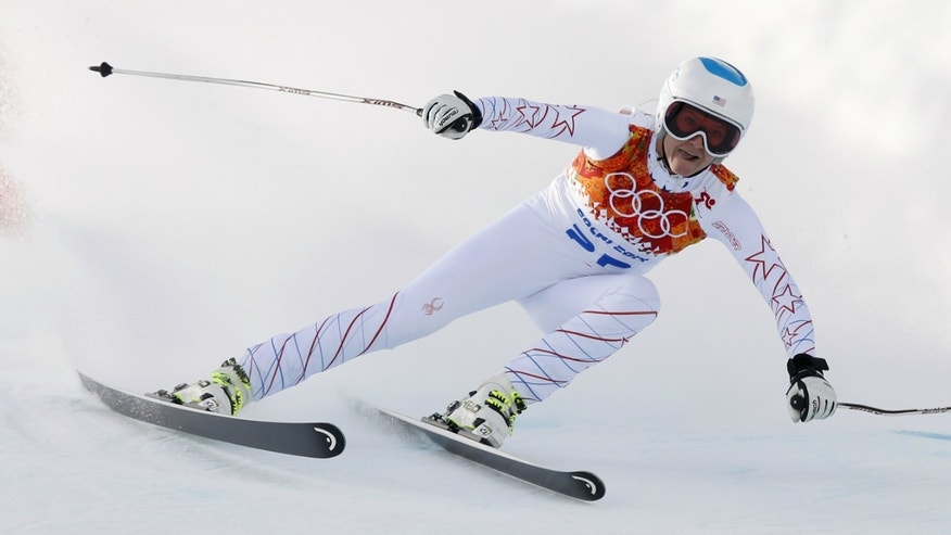 Julia Mancuso of the U.S. skis during the downhill run of the women's alpine skiing super combined event at the 2014 Sochi Winter Olympics at the Rosa Khutor Alpine Center.