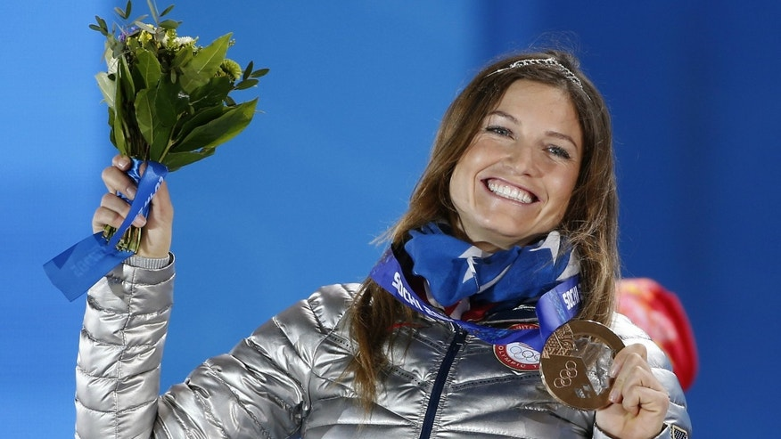 Bronze medalist Julia Mancuso of the U.S. celebrates on the podium during the medal ceremony for the women's alpine skiing super combined event at the Sochi 2014 Winter Olympics.