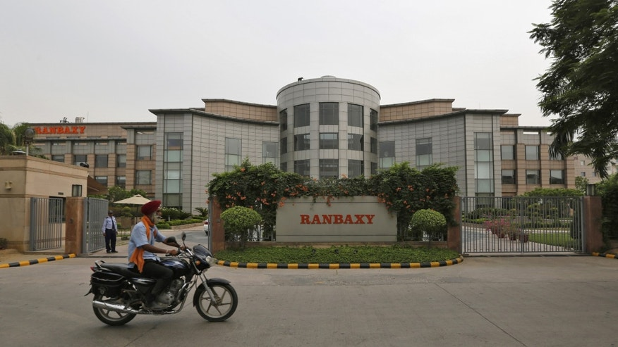 A man rides a motorcycle in front of the office of Ranbaxy Laboratories at Gurgaon, on the outskirts of New Delhi, June 13, 2013. (REUTERS/Adnan Abidi)