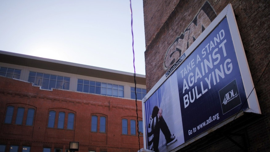 An anti-bullying billboard hangs on a building in downtown Boston, Massachusetts March 3, 2011.  (REUTERS/Brian Snyder)