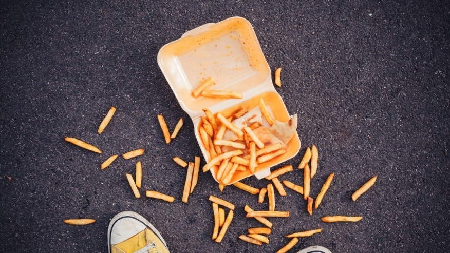 Young man has dropped his chips in the street
