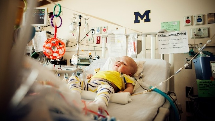 Garrett Peterson resting in his hospital bed at C.S. Mott Children's Hospital.