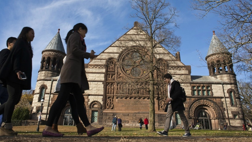 People walk around the Princeton University campus in New Jersey.