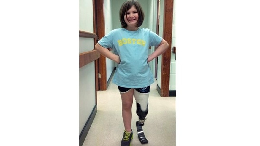 March 21, 2014: This photo released by the Richard family shows daughter Jane Richard wearing prosthetic leg fitted the preceding week in Boston.