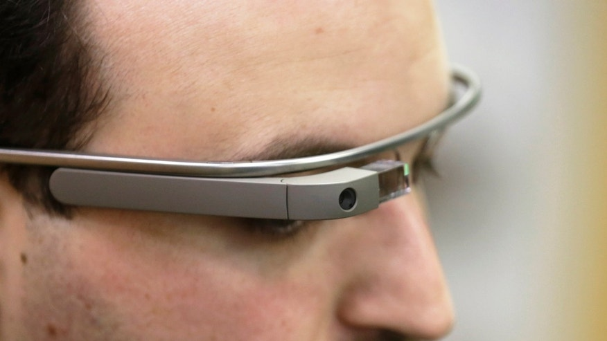 Developer Maximiliano Firtman wears the prototype device Google Glass before a news conference. (REUTERS/Ints Kalnins)