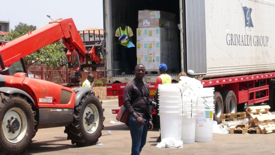 Workers from Doctors Without Borders unload emergency medical supplies to deal with an Ebola outbreak in Conakry, Guinea, March 23, 2014. (REUTERS/Saliou Samb)