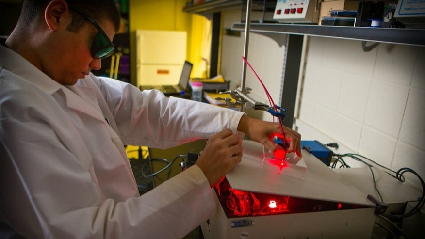Kevin Carter, a chemical and biological engineering undergraduate at the University of Buffalo, using a red laser.